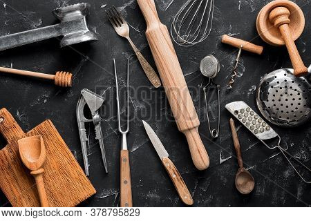 Various Kitchen Utensils And Tools On A Black Stone Background. Top View, Flat Lay, Copy Space. Coll