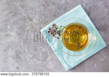Herbal Treatment. Tea With Oregano In A Glass Cup On The Table. Relaxing Drink. Top View. Copy Space
