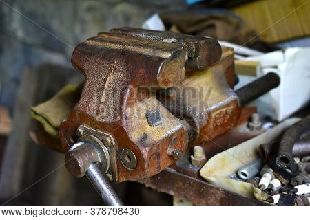 Red Massive Locksmith Iron Vise On An Iron Table