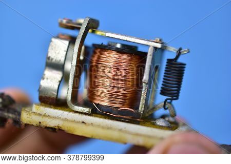 Copper Coil Switch In The Hands Of A Master