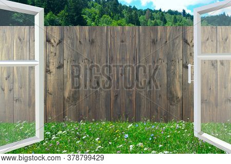 Open Window Overlooking The Fence. Window Overlooking The Summer Courtyard With Wooden Fence. View F