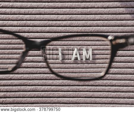 Top View On Letterboard With Words I Am Through Eyeglasses. Flat Lay Concept Of Psychological Self-r