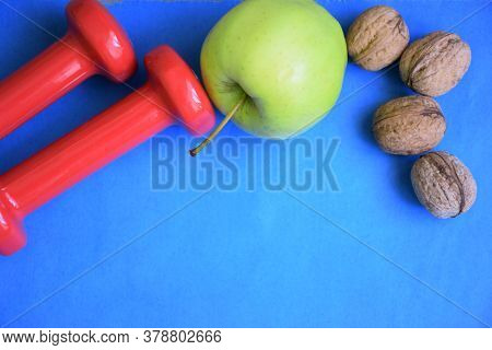 Diet Plan, Dumbbells And Fresh Fruits Diet Food On Blue Background, Weight Loss And Diet Concept, To