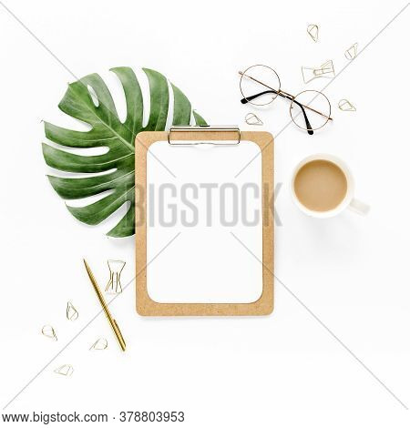 Workspace With Clipboard And Leaf Monsters On White Background. Flat Lay Of Home Office Desk, Top Vi