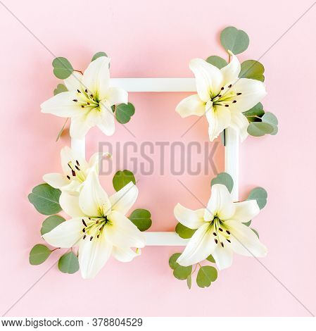 Floral Frame Made Of White Lilies And Eucalyptus Leaves On Pink Background. Flat Lay, Top View Flora