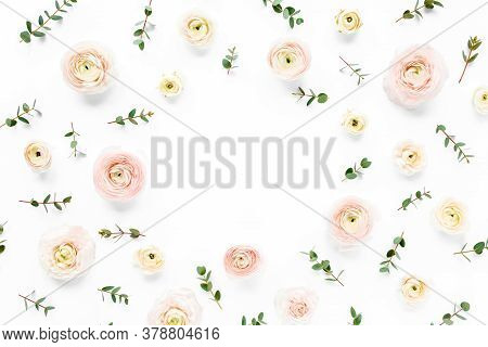 Floral Frame Made Of Pink Ranunculus Flower Buds And Eucalyptus Branches On White Background. Flat L