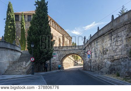 Salamanca, Spain, July 2020 - Steps And Stone Arched Bridge With Las Duenas Convent In The Backgroun