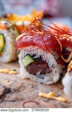 Japanese Food, Fresh Sushi Or Sashimi Made From Rice With Raw Tuna Fish, Avocado, Cucumber, Red Fish
