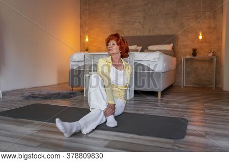 Beautiful Active Senior Woman Doing Yoga Session At Home - Healthy And Active Lifestyle Of Elderly P