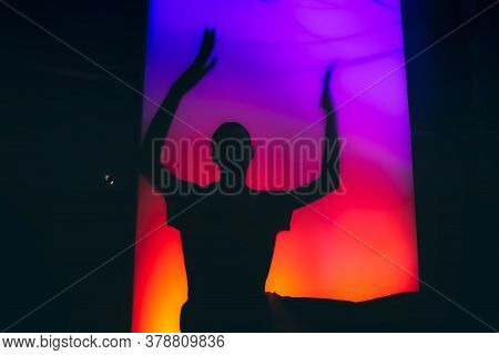 Dancing Silhouette Of Man At The Techno Party