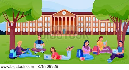 Students With Books, Laptops Sitting On Lawn Of University College Campus. Pupils Learning Outdoor.