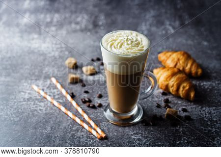 Coffee With Whipped Cream In A Glass With Coffee Beans