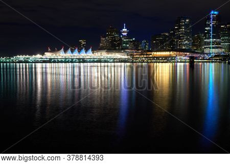 Vancouver Night Skyline Burrard Inlet. A Calm Burrard Inlet Next To Stanley Park In The Early Evenin