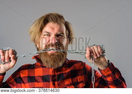 Freedom Of Speech. Metal Chain. Man Bite Chain. Man With Metal Chain. Dependence. Freedom Concept. S