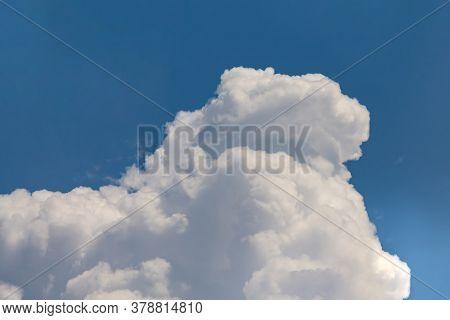 Huge Cumulonimbus High In The Blue Sky
