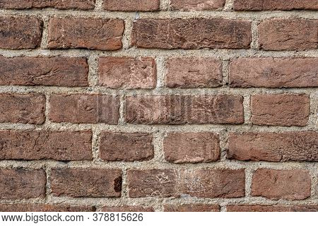 Brick Wall Texture Background. Pattern Of Weathered Old Cracked Brickwall. Stacked Stones Wall Rough