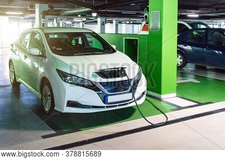 Green Concept Car. Hybrid Vehicle - Green Technology Of Future. Electric Car Charge Battery On Eco E
