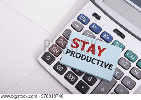 Word Writing Stay Productive In The Office On Calculator Business Concept For Concentration Efficien