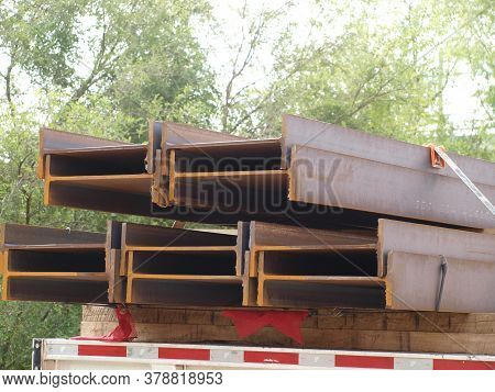 Steel I Beams On A Flatbed Truck Is About To Be Unloaded For The Architectural Project That Has A Be