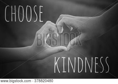 Inspirational Quote - Choose Kindness. With Hands Making Love Sign On Black And White Background. Be