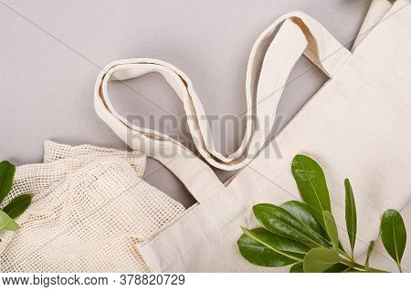 Textile Bag For Shopping, On A Gray Background. Eco Household Goods. The Concept Of Recycling And Re