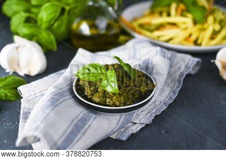 Traditional Italian Pesto Sauce In A Plate On A Black Table. For Fusilini Pasta. Vegetarian Food, Fo
