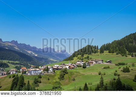 Italy, Dolomites, The Moena Village And In The Background  Catinaccio Mountain