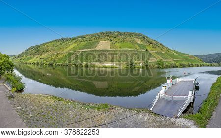 Scenic Panoramic View Of The Mosel River With Ferry In Briegel.
