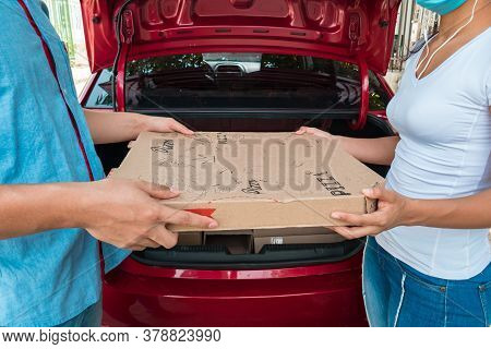 A Woman Sorting Boxes For Delivery. Concept Of Domicile