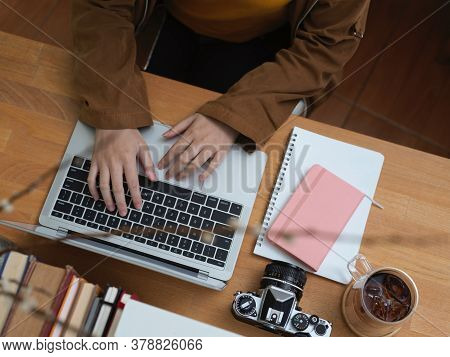 Female Office Worker Working With Laptop On Worktable In Office Room