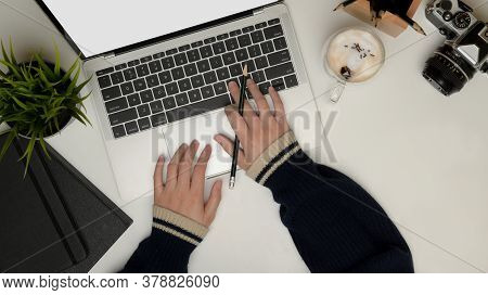 Female Using Laptop On Office Desk With Camera, Stationery, Coffee Cup And Decorations, Clipping Pat