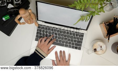 Female Working On Laptop With Clipping Path On Office Desk
