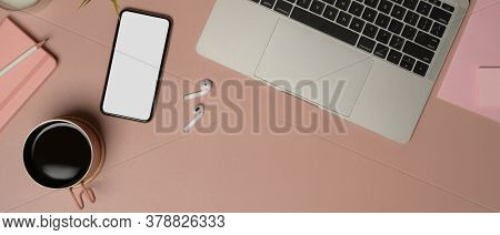 Top View Of Feminine Worktable With Smartphone, Laptop, Accessories, Coffee Cup And Copy Space