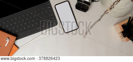 Simple Workspace With Clipping Path Smartphone, Office Supplies And Copy Space On Marble Table