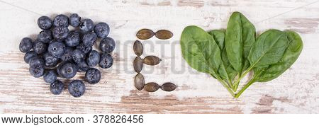 Blueberries, Pumpkin And Spinach Containing Vitamin E And Dietary Fiber, Natural Sources Of Minerals