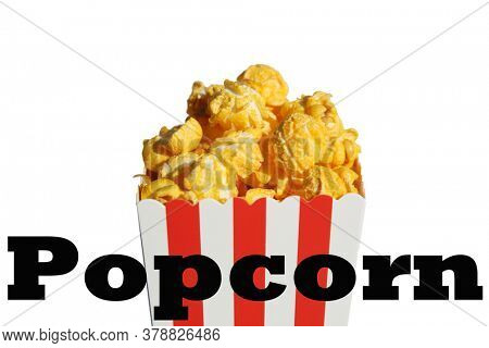Popcorn. Popcorn in a White and Red Striped Container. Isolated on white. Popcorn Text. Popcorn is enjoyed world wide by happy people and animals alike. Room for text. Clipping Path.
