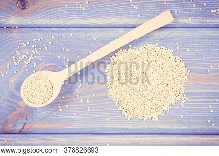 Vintage Photo, Heap Of Quinoa Seeds With Wooden Spoon As Source Vitamins, Healthy Nutrition Concept