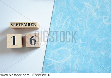 September 16, Empty White - Blue Background With Number Cube.