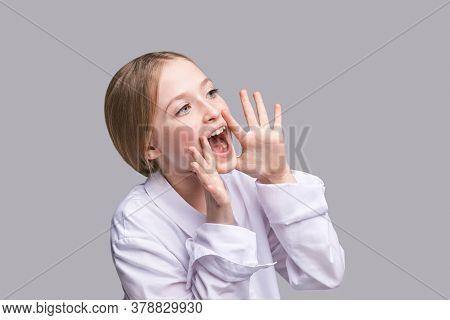 Girl Shout. Little Lady Scream About Sale. Looking Side. Pretty Kid With Hands Near Head. Child Port