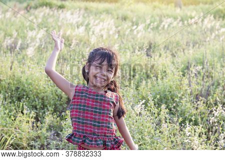 Asian Little Girl Wore A Dress Made Of Thai Loincloth Or Kamar Band Or Commer Band Standing And Laug