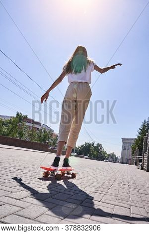 Student Girl At Pink Skateboard. Local City Traveller. Staycation Lifestyle. Back View Teenager. Cop