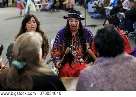 San Francisco, Usa - February 08, 2020: Native American Women Sing A Song At Pow Wow, Face Paint For