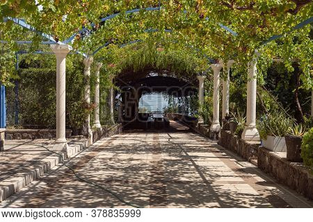 Tiberias, Israel, July 18, 2020 : A Shady Alley Leading To The Sea Of Galilee Is Located On The Terr