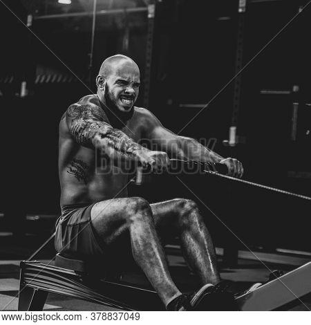 Man On Rowing Machine