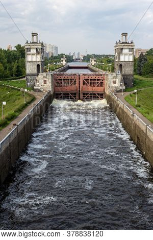 The River Lock Is Filled With Water To Allow The Ship To Pass. Locks For Vessels On The Moscow Canal