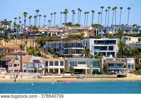 July 30, 2020 In Corona Del Mar, Ca:  Homes On A Bluff Surrounded By Palm Trees With Quaint Neighbor