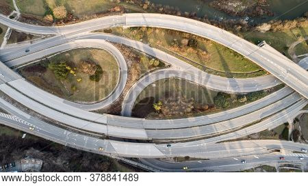 Top Down View Of Highway Multi Level Junction Road With Moving Cars. View Of Traffic Jam Passing Thr