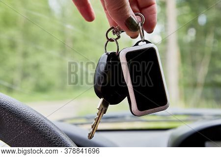 Hand Of Woman Holding Car Key In A Car.