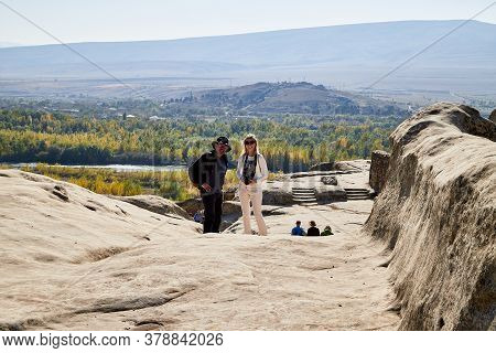 Uplistsikhe, Georgia - October 22, 2020: Tourists In A Mountain Reserve Near Ancient Old City With R
