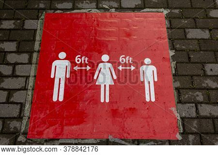 Red Sign On The Floor That Informs People To Keep A Social Distance. Sign Informing People To Keep 6